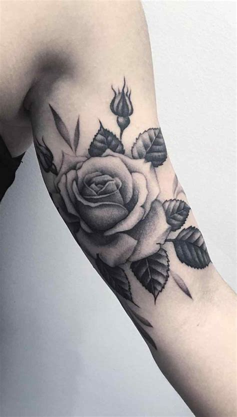 rose tattoo with writing small tattoos on spine for