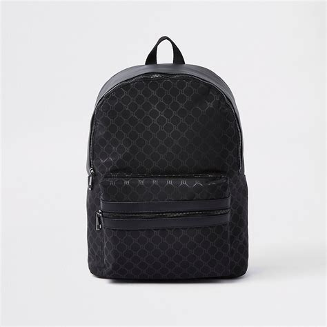 black faux leather ri monogram backpack backpacks