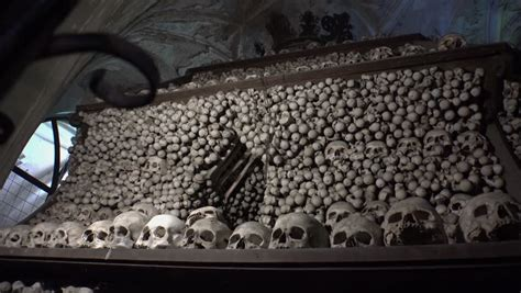 Define Charnel House by Skulls Placed On Shelf Into An Ossuary At Poschiavo Switzerland Tilt Uhd 4k Stock Footage