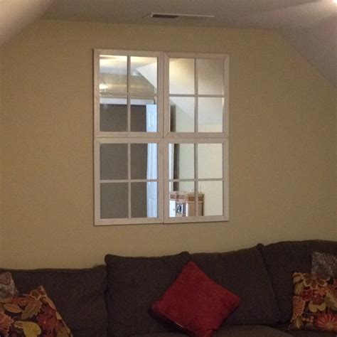 make your window less walls brighter by adding pane style mirrors to look like real windows