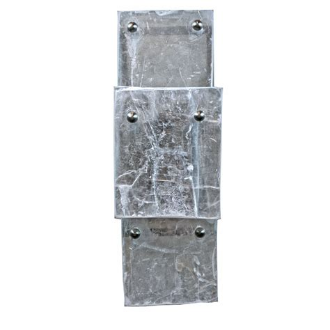 vertical fixtures or sconces mounted on either side of the modern vertical mount selenite sconce art deco decor