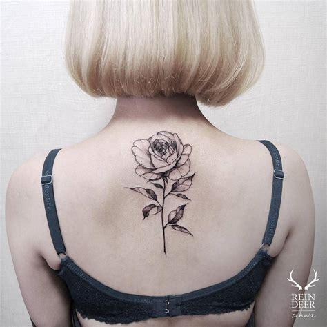 rose tattoo on upper back blackwork illustrative on the back