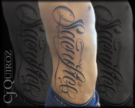 cj tattoo beautiful quot sacrifice quot lettering on ribs by cj