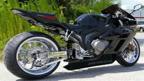 motorcycle swing arm extension written in chrome created by motorcycle enthusiasts for