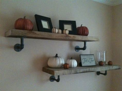 floating shelves supported by pipes industrial and