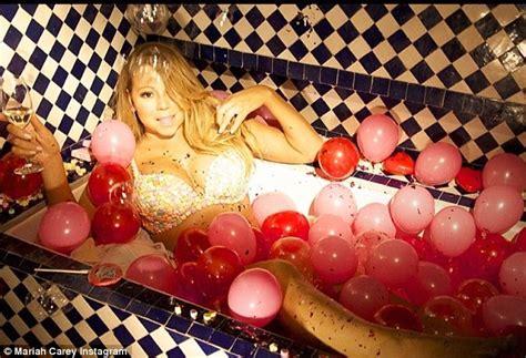 Mariah Carey In Bathtub Mariah Carey Takes The Plunge In Elegant Scarlet Gown As