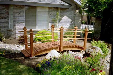Yard Bridge | 12 foot redwood garden bridge with posts and double rails