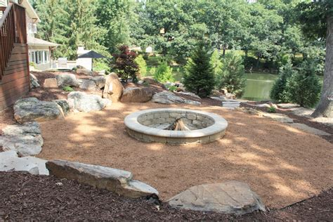 Pebble Pit pit has boulder seating and pebble rock surround 171 terracarelandscape net