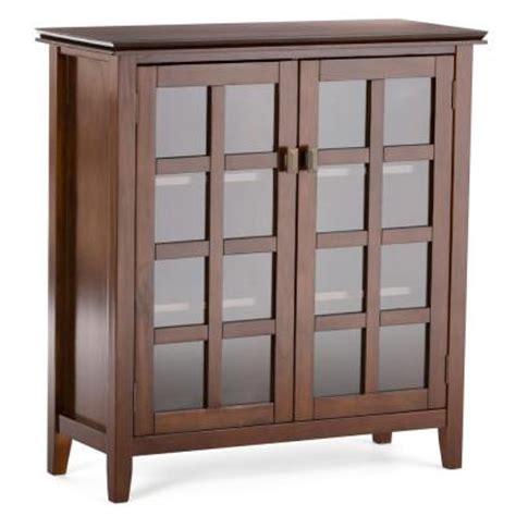 simpli home artisan medium storage cabinet simpli home artisan storage cabinet in medium auburn brown