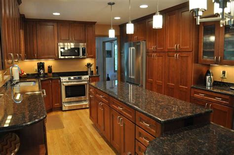 black granite countertops with cherry cabinets