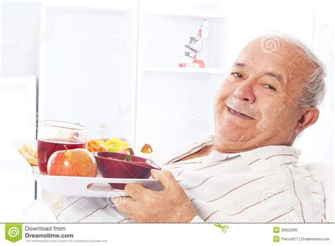 man in hospital bed elderly man in a hospital bed eating stock photo image 28052080