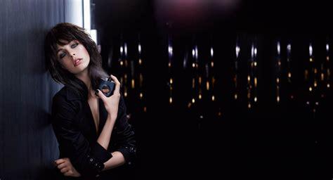 Log In To Win A Yves Laurent Black Patent Tribute Bag by Perfume Black Opium De Yves Laurent