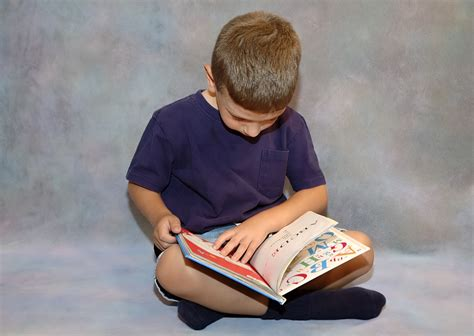 picture of a child reading a book reading and child development research findings