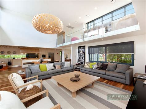 Split level living room using grey colours with tiles & built in shelving   Living Area photo 228568