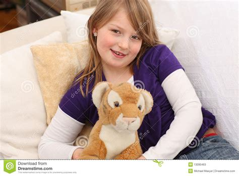 little girls sofa little girl with toy tiger on sofa stock photos image