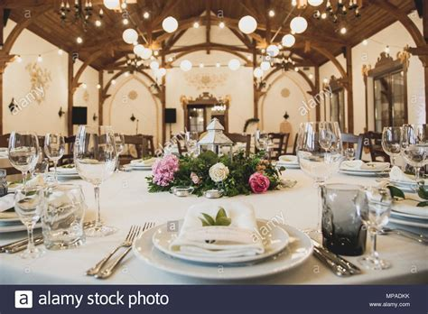 luxury wedding decor with flowers and glass vases and