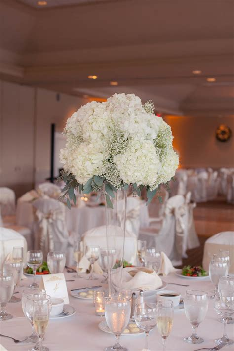 white flower wedding arrangements white hydrangea and baby s breath wedding centerpiece
