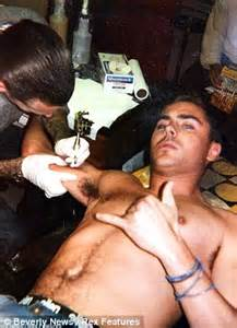 Bed Stu Mens Zac Efron Shows Off His Touched Up Feather Tattoo On His