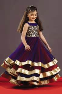 picture of three layered stunning kids gown in blue amp red
