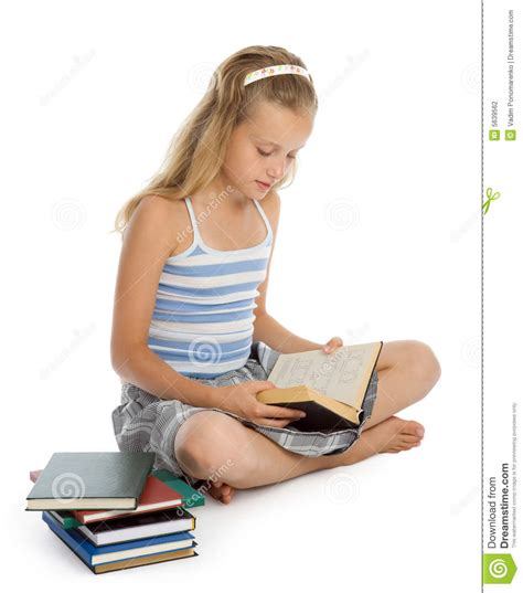 sit on floor and reading book stock