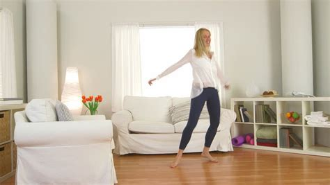 living room dancers pretty blond in a white with gray