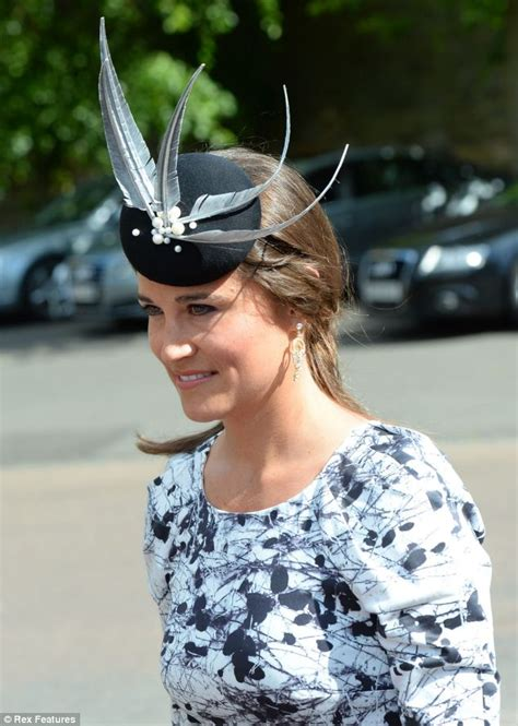 Pippa demure in peplum dress as she arrives at society wedding which Kate is forced to miss