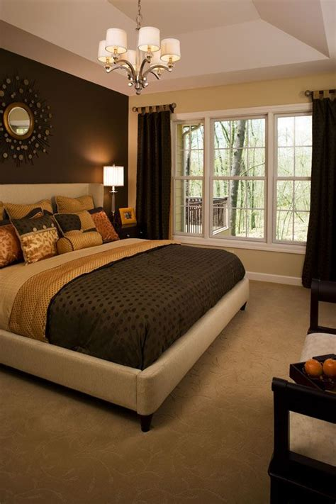 warm bedroom colors master bedroom the dark wall serves as a great focal