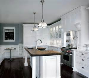 kitchen white cabinet beside hoods above stove and oven closed dark floor plus nice counter