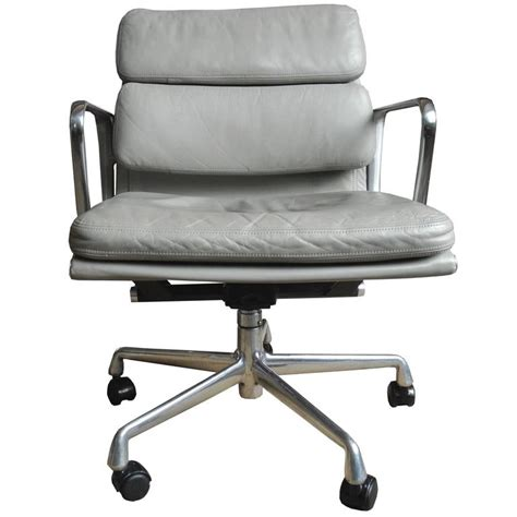 Eames Soft Pad Chair by Eames Soft Pad Chair In Light Gray Leather On Wheels For