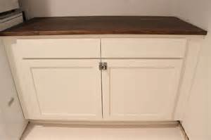 ikea desk top turned laundry room cabinet top