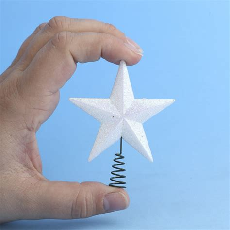 small white iridescent star tree topper trees and