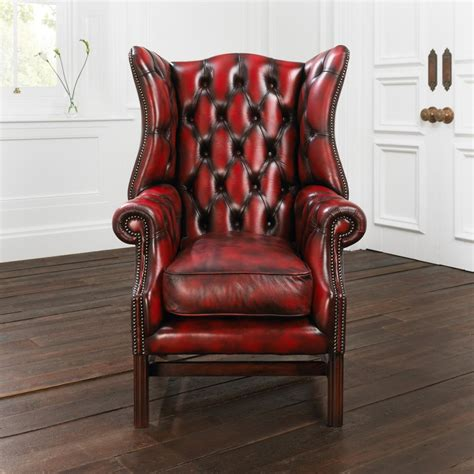 Leather Wingback Chair Design Ideas Leather Wingback Chair With Wooden Floor And White Wall For Home Interior Design Ideas