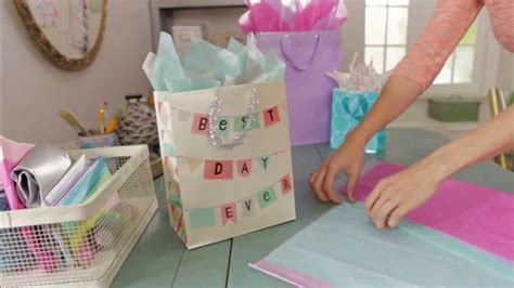 How To Fold Gift Tissue Paper - giftology how to fill a gift bag with tissue