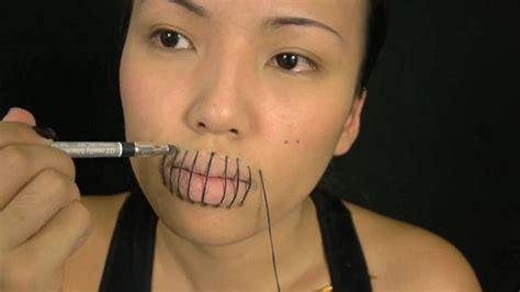 makeup tutorial girl slams head makeup artist promise phan creates scary halloween sewn up