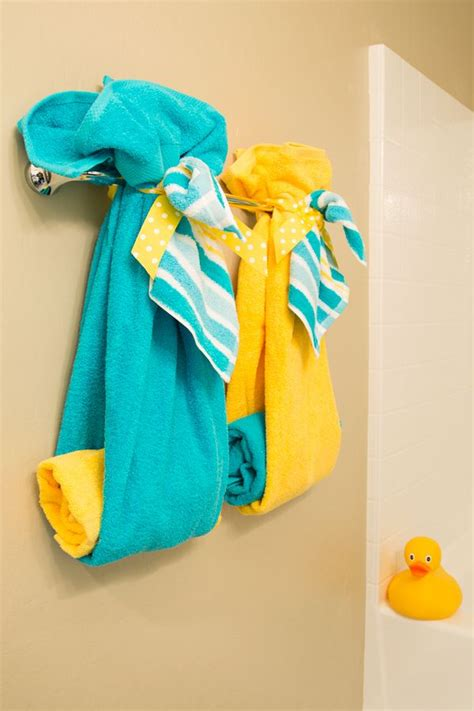 turquoise and yellow 25 best ideas about bathroom towel display on pinterest