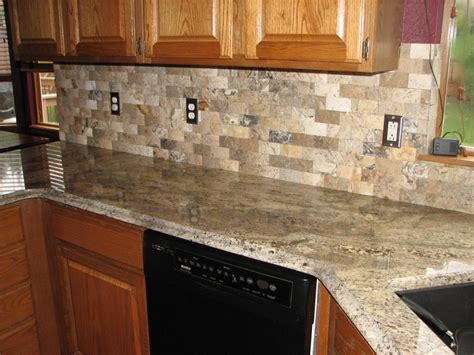 kitchen countertops backsplash grey range philadelphia travertine mosaic brick tile backsplassh and granite countertop