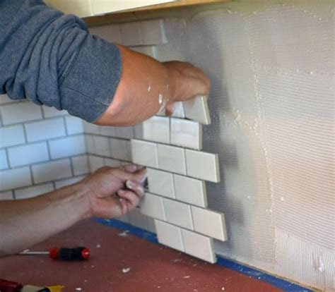 how to install a backsplash in kitchen subway tile backsplash install diy builds reno repairs pintere