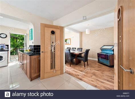 a view through double solid wood doors from a kitchen in