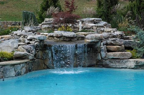 best pool waterfalls ideas for your swimming pool