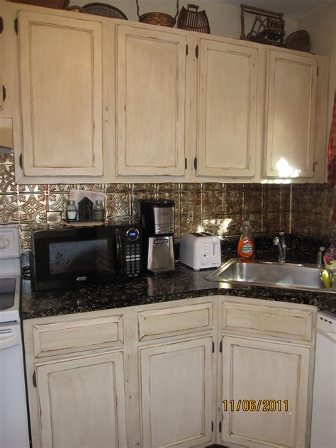 Reclaim Paint Kitchen Cabinets Distressed Cabinets With Reclaim White Then Glazed Plastic Ceiling Tile Backsplash