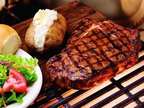 Our T Bone Steak Is Basted With Our Secret Sauce Then Steak House Seal