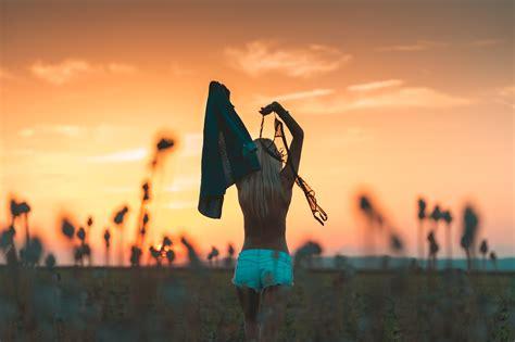 free stock image enjoying freedom and throwing bra away