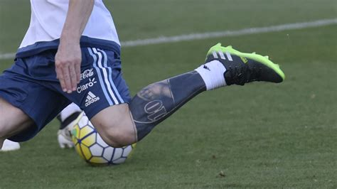 messi tattoo on leg ta two messi covers up old leg ink goal com