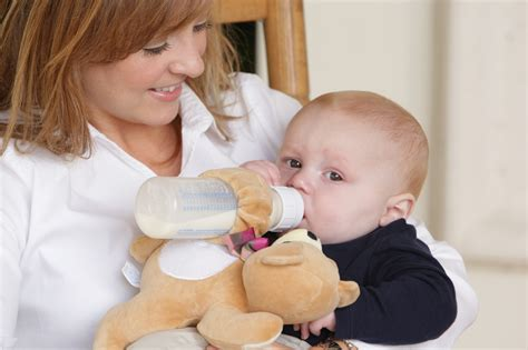 what to feed newborn puppies without bottle snugglers r baby bottle holders picked up by right start r baby stores