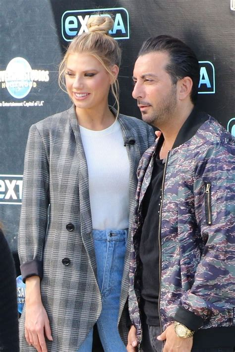 charlotte mckinney on the set of extra in universal city charlotte mckinney and danny abeckaser on the set of extra