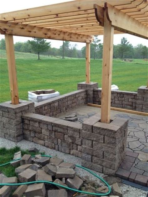 how to build a backyard patio how to build a seat wall and pergola columns repinned by normoe the backyard guy