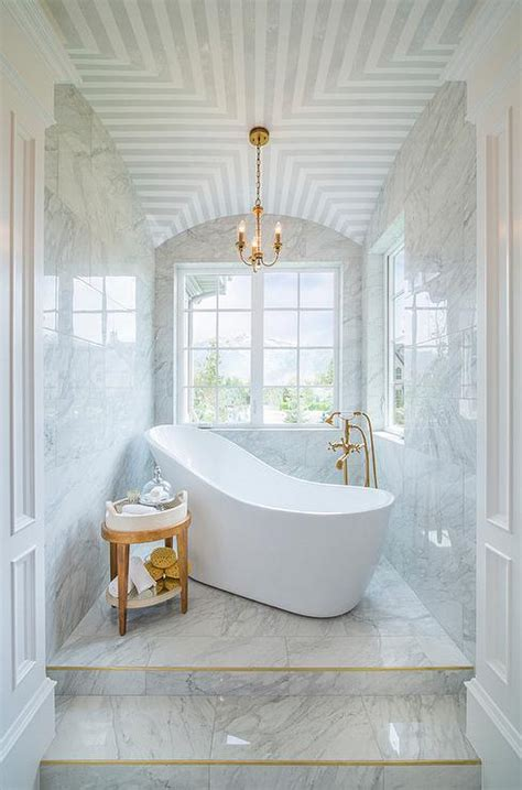 marble steps  freestanding tub transitional bathroom
