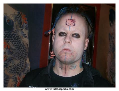 cross tattoo forehead 2