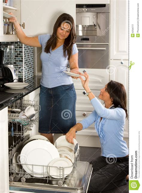 unloading  dishwasher royalty  stock photography