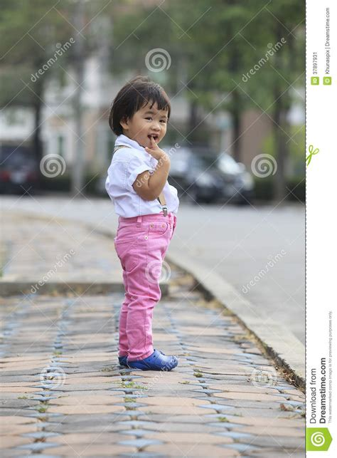 St Emzo Kid Gmb asian kid children standing beside road with relaxing stock image image 37897931